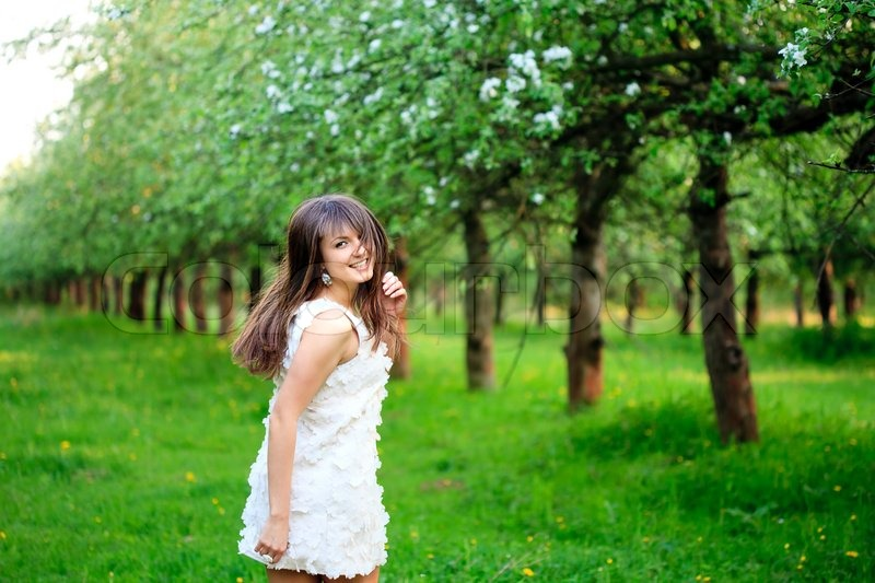 1887673-young-attractive-girl-running-in-the-garden